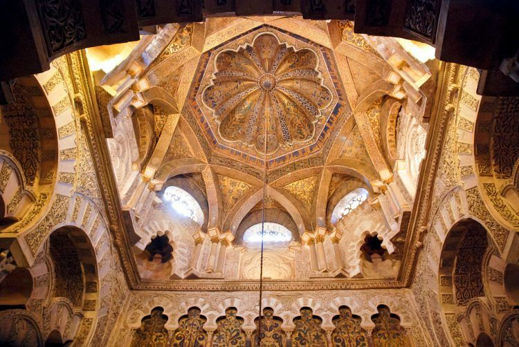 A view from within the mosque of the dome, showing an intricate use of arches.