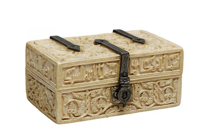 A small ivory box with intricate designs.