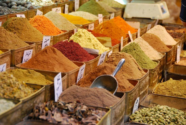 A picture of bins of spices in a market.