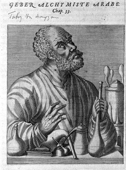A man holding chemistry tools at his desk.