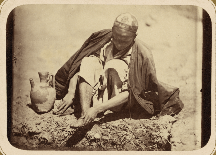 A picture of a Muslim performing ritual wudu, or washing before prayer (circa 1865).